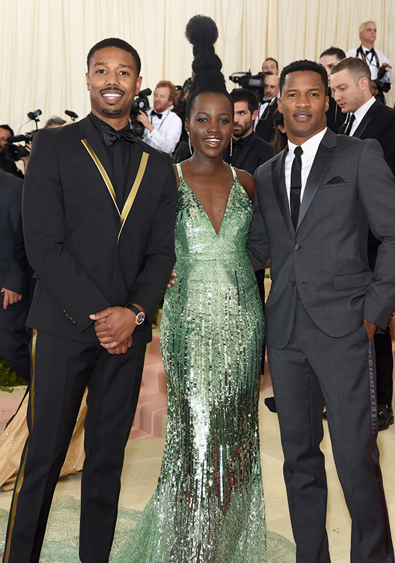"""NEW YORK, NY - MAY 02: (L-R) Michael B. Jordan, Lupita Nyong'o and Nate Parker attend the """"Manus x Machina: Fashion In An Age Of Technology"""" Costume Institute Gala at Metropolitan Museum of Art on May 2, 2016 in New York City. (Photo by Jamie McCarthy/FilmMagic)"""